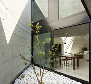 beautiful modern house in cement, dining room view from the veranda
